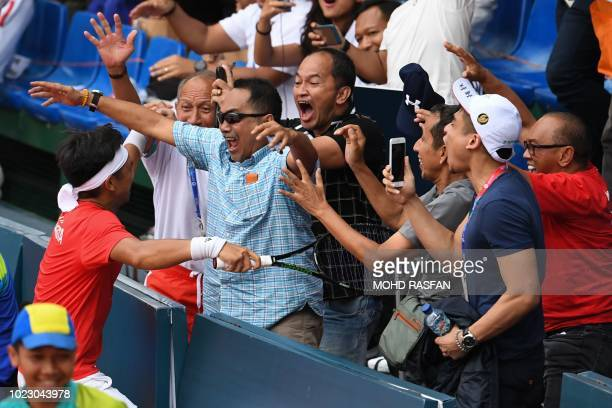 Indonesia's Christopher Benjamin Rungkat celebrates his gold medal win against Thailand during the mixed doubles tennis at the 2018 Asian Games in...