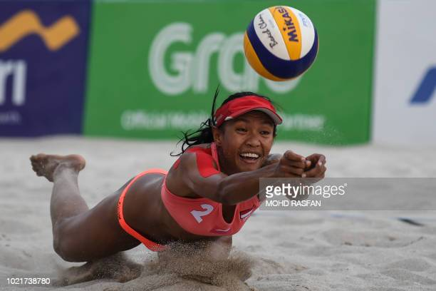 Indonesia's Dhita Juliana dives for a return against Thailand in the women's beach volleyball pool D during the 2018 Asian Games in Palembang on...