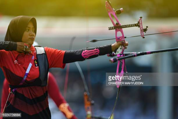 Indonesia's Diananda Choirunisa competes in the archery recurve women's individual final round against China's Zhang Xinyan at the 2018 Asian Games...