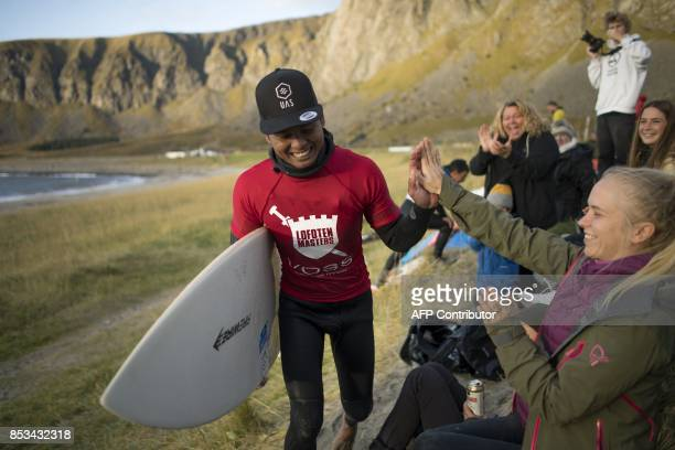 Indonesia's Edi Siswanto celebrates his victory during the Lofoten Masters 2017 the northernmost surf contest in the world on September 23 2017 Water...