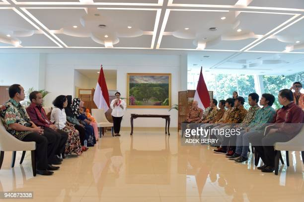 Indonesia's Foreign Minister Retno Marsudi delivers a speech at a government handover ceremony reuniting a group of captives recently returned from...