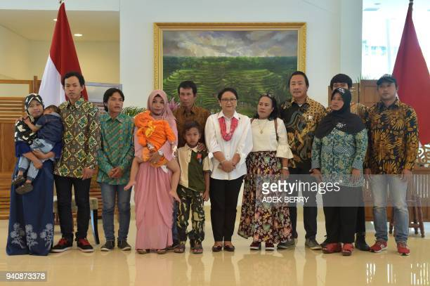 Indonesia's Foreign Minister Retno Marsudi poses with recently released hostages from Libya and their families at a government handover ceremony...