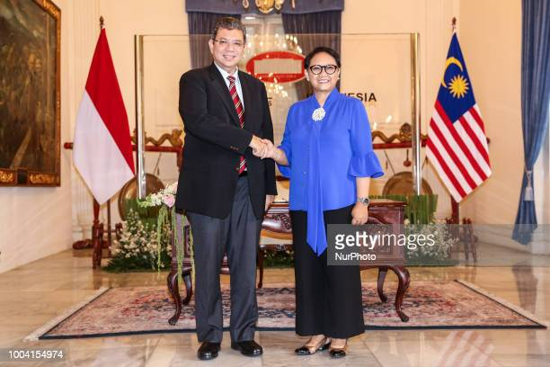 Malaysian Foreign Minister Saifuddin Abdullah talks to media after bilateral meeting in Jakarta Indonesia on Monday July 23 2018 Abdullah is visiting...