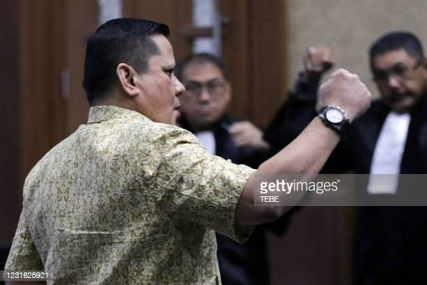Indonesia's former police inspector general Napoleon Bonaparte reacts in a courtroom after he was sentenced to four years in prison for accepting...