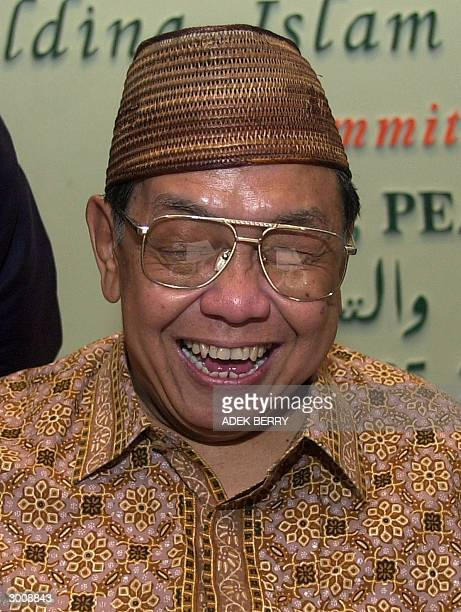 Indonesia's former president Abdurrahman Wahid laughs as he talks to the press at a Muslim conference in Jakarta 24 February 2004 Wahid who was...