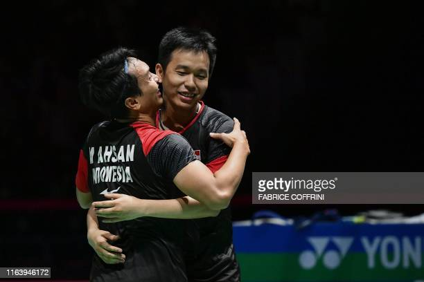 Indonesia's Hendra Setiawan and Mohammad Ahsan celebrate their victory over Japan's Yugo Kobayashi and Japan's Takuro Hoki during their men's doubles...