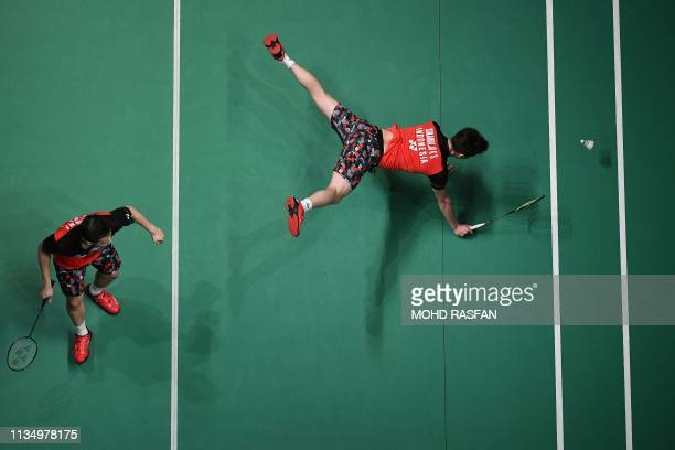 TOPSHOT Indonesia's Kevin Sanjaya Sukamuljo dives for a return while teammate Marcus Fernaldi Gideon looks on during their men's doubles quarterfinal...
