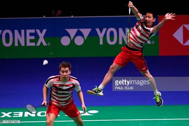 Indonesia's Kevin Sanjaya Sukamuljo returns as his partner Indonesia's Marcus Fernaldi Gideon stands ready against Denmark's Mathias Boe and...