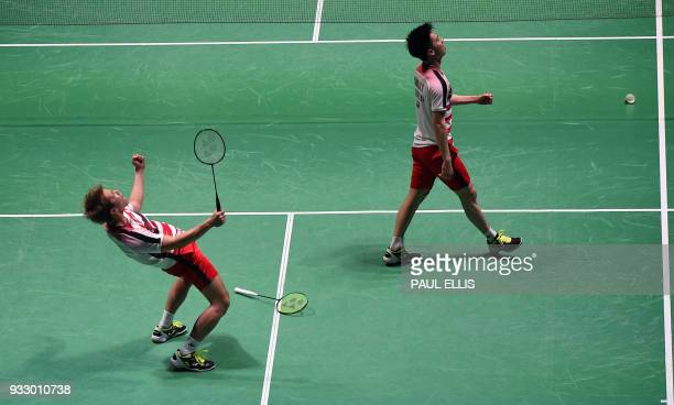 Indonesia's Marcus Fernaldi Gideon and Kevin Sanjaya Sukamuljo celebrate beating Denmark's Mads ConradPetersen and Mads Pieler Kolding during their...
