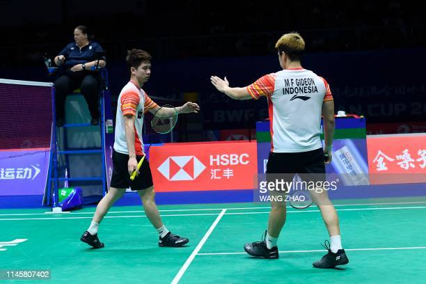 Indonesia's Marcus Fernaldi Gideon and Kevin Sanjaya Sukamuljo react after winning a point against Taiwan's Lee Yang and Wang ChiLin during their...