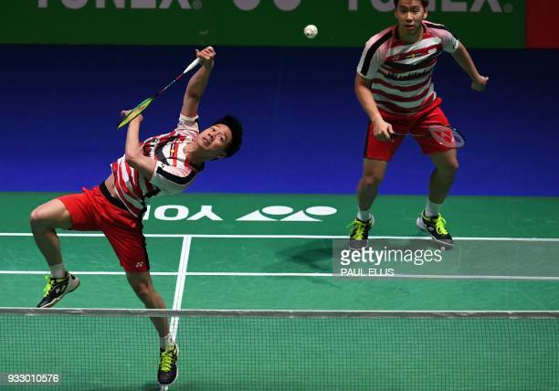 Indonesia's Marcus Fernaldi Gideon and Kevin Sanjaya Sukamuljo return against Denmark's Mads ConradPetersen and Mads Pieler Kolding during their...