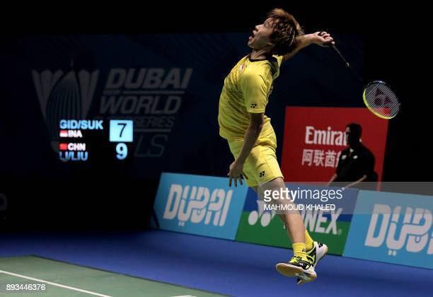 TOPSHOT Indonesia's Marcus Fernaldi Gideon returns a shot with his partner Kevin Sanjaya Sukamuljo to China's Li Junhui and Liu Yuchen during the...