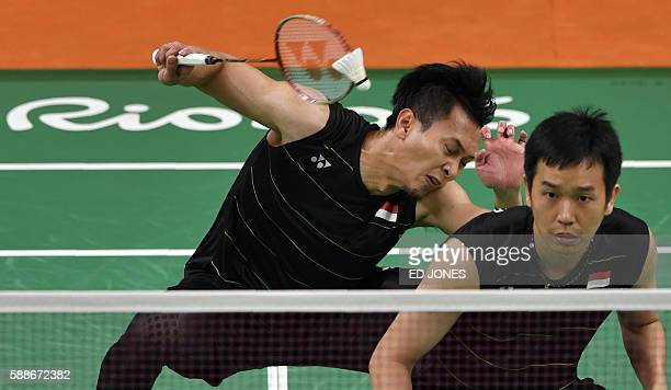 Indonesia's Mohammad Ahsan and Indonesia's Hendra Setiawan return to Japan's Kenichi Hayakawa and Japan's Hiroyuki Endo during their men's doubles...