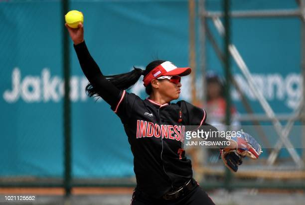 TOPSHOT Indonesia's Monica Isella pitches during the women's preliminary softball match between Phillippines and Indonesia at the 2018 Asian Games in...