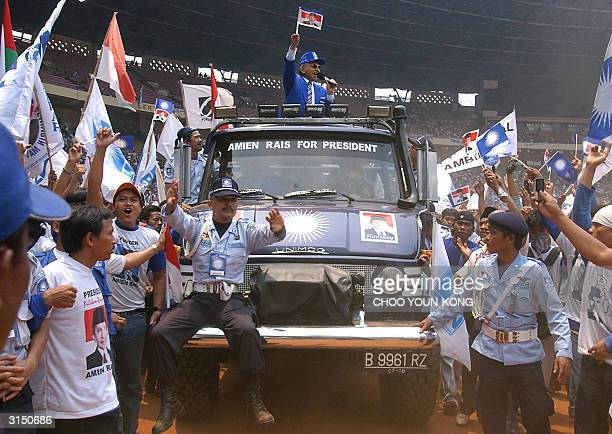 Indonesia's National Assembly chairman and leader of National Mandate Party Amien Rais waves to supporters as he campaigns for the parliament...