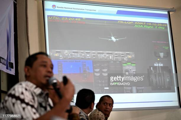 Indonesia's National Transportation Safety Committee investigator Nurcahyo Utomo briefs journalists during a press conference on the final report of...