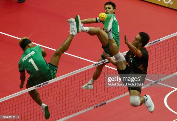 Indonesia's player blocked a ball during against Malaysia Sepak Takraw Men's team competition on day one of the 2017 SEA Games on August 18 2017 in...