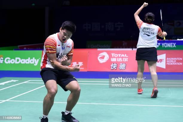 Indonesia's Praveen Jordan and Melati Daeva Oktavianti celebrate beating Taiwan's Hsieh Pei Shan and Wang Chi Lin during their mixed doubles...
