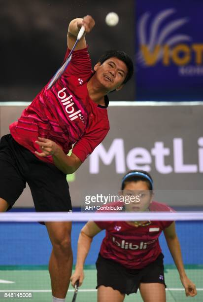 Indonesia's Praveen Jordan plays a shot beside his partner Debby Susanto against China's Wang Yilyu and Huang Dongping during their mixed doubles...