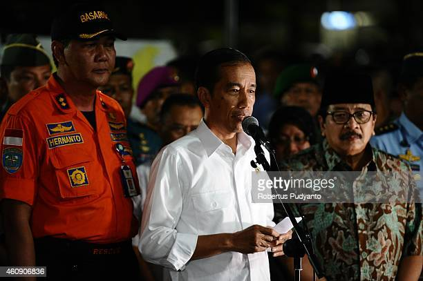 Indonesia's President Joko Widodo speaks during press conference at AirAsia crisis center Juanda International Airport on December 30, 2014 in...