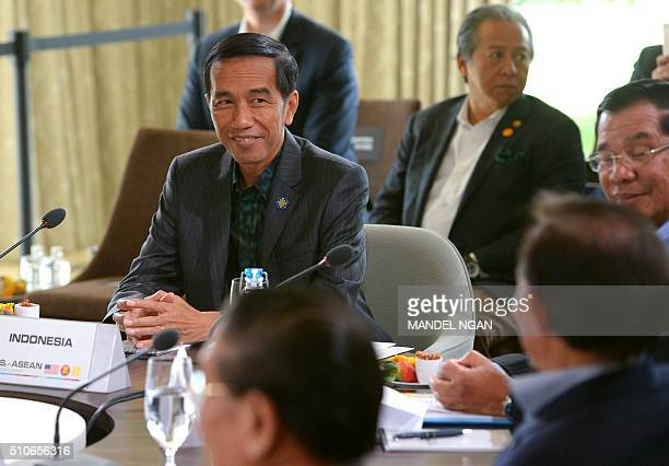 Indonesia's President Joko Widodo takes part in a security in AsiaPacific plenary session hosted by US President Barack Obama during a meeting of the...
