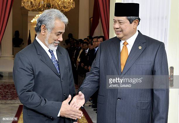 Indonesia's President Susilo Bambang Yudhoyono shakes hands with East Timor Prime Minister Xanana Gusmao before a meeting at the presidential palace...