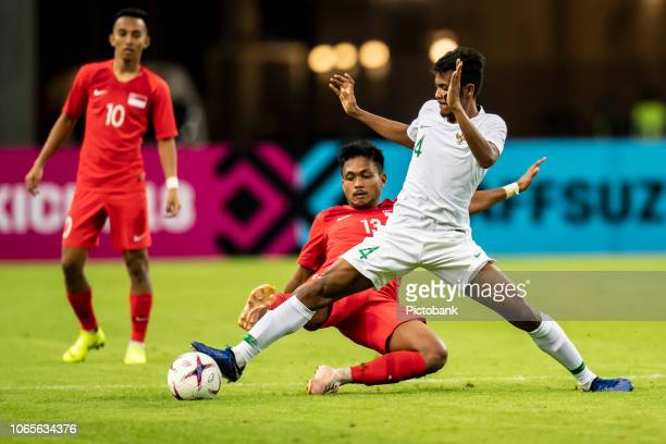 Indonesia's Rizky Pora fights for the ball with Singapore's Izzdin Shafiq during the AFF Suzuki Cup Group B match between Singapore and Indonesia at...