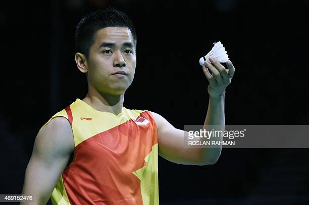 Indonesia's Simon Santoso requests a new shuttle cock from the umpire during a match against Thailand's Tanongsak Saensomboonsak in their men's...