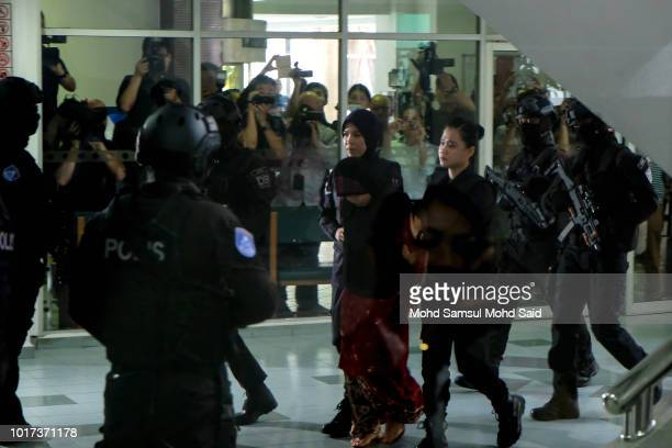 Vietnamese's Doan Thi Huong escorted by police arrives at the Shah Alam High Court for her trial in the murder case of Kim Jong Nam North Korean...