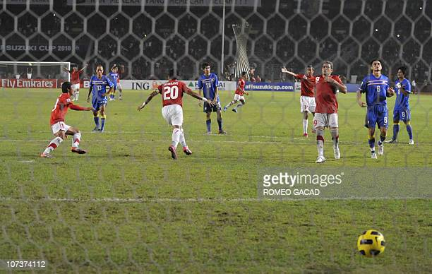 Indonesia's striker Bambang Pamungkas jubilates after scoring in a penalty kick during their AFF Suzuki Cup 2010 group A football match in Jakarta on...