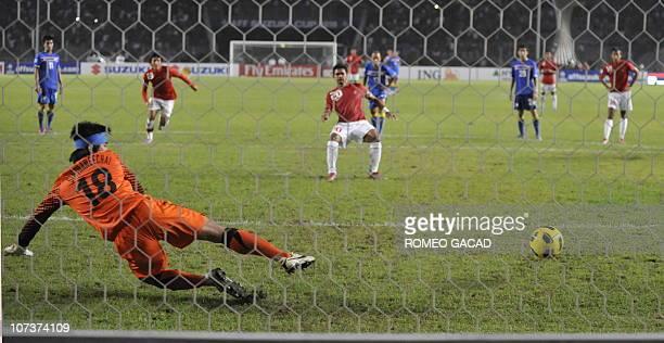Indonesia's striker Bambang Pamungkas scores a penalty kick during their AFF Suzuki Cup 2010 group A football match in Jakarta on December 7 2010...