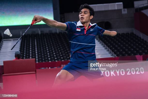 Indonesia's Suryo Nugroho hits a return against Indoesia's Dheva Anrimusthi during their men's singles SU5 group A badminton match during the Tokyo...