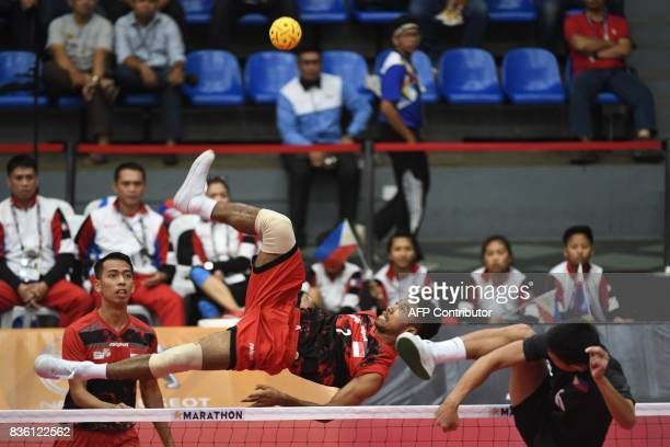 Indonesia's Syaiful Rijal competes with Regie Reznan Fabriga of the Philippines during their men's team doubles preliminary round robin sepak takraw...