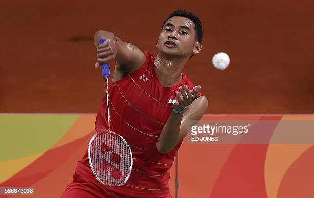 Indonesia's Tommy Sugiarto returns to US Howard Shu during their men's singles qualifying badminton match at the Riocentro stadium in Rio de Janeiro...