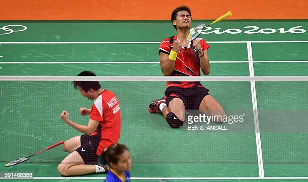 Indonesia's Tontowi Ahmad and Indonesia's Liliyana Natsir react after winning against Malaysia's Liu Ying Goh and Malaysia's Peng Soon Chan during...