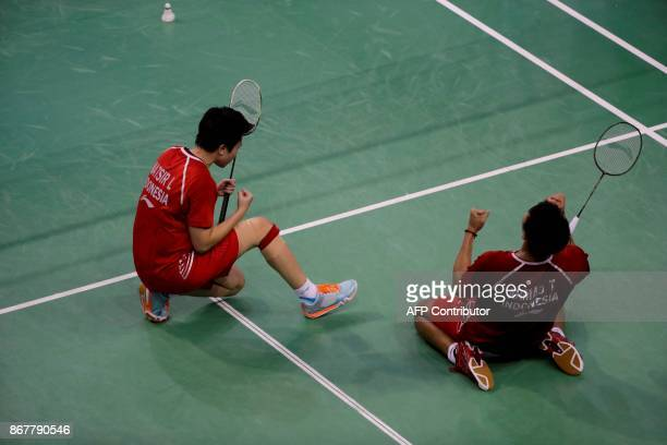 Indonesia's Tontowi Ahmad and Liliyana Natsir celebrate after they won the Badminton Yonex French Open Mixed Doubles final badminton match on October...