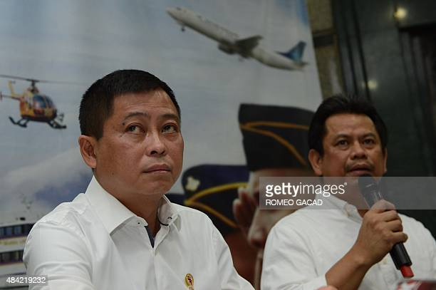 Indonesia's Transport Minister Ignasius Jonan looks on as Director General for Air Transportation Suprasetyo speaks during a press conference in...