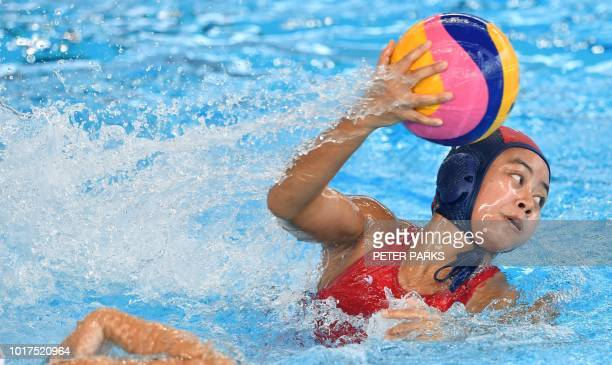 Indonesia's Upiet Sarimanah throws the ball against Japan in the womens water polo preliminary Group A event during the 2018 Asian Games in Jakarta...