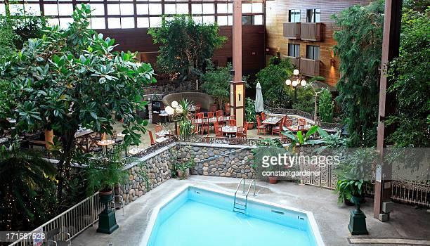 indoor atrium and pool of hotel - building atrium stock pictures, royalty-free photos & images