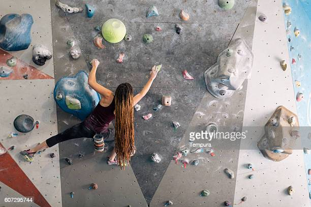 Indoor climbing in the bouldering gym wall.