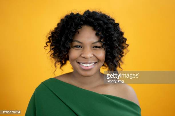 indoor headshot portrait of cheerful 29 year old black woman - mid length hair stock pictures, royalty-free photos & images