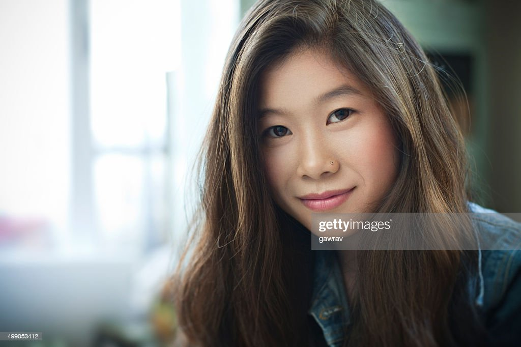 Indoor Image Of Beautiful Happy Asian Girl Looking At Camera Stock -1458