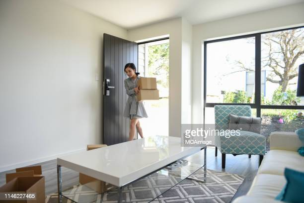 indoor life portrait of a young asian woman - house rental stock pictures, royalty-free photos & images