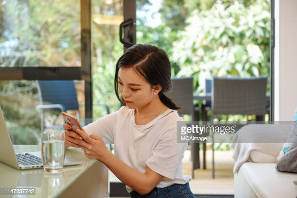 indoor life portrait of a young asian woman - next to stock pictures, royalty-free photos & images