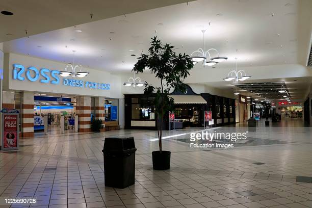 Indoor mall view of a Ross Dress for Less entrance showing few shoppers, northern Idaho.