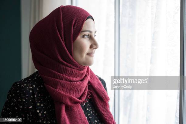 indoor portrait of early 30s british asian woman in hijab - religious dress stock pictures, royalty-free photos & images