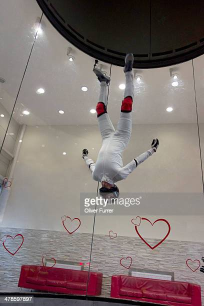 Indoor skydiver flying head over in the tunnel