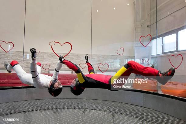 Indoor skydivers back flying together