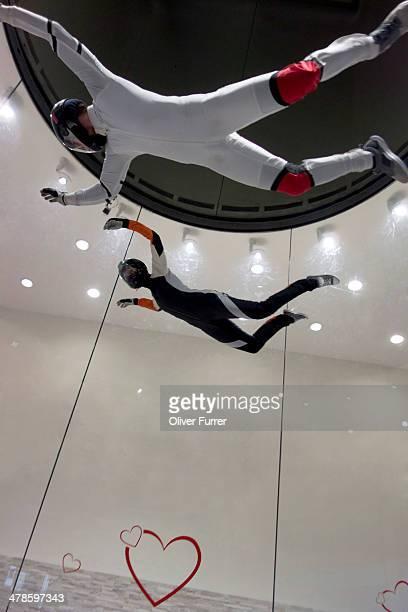 Indoor skydivers practising the freefall scenario