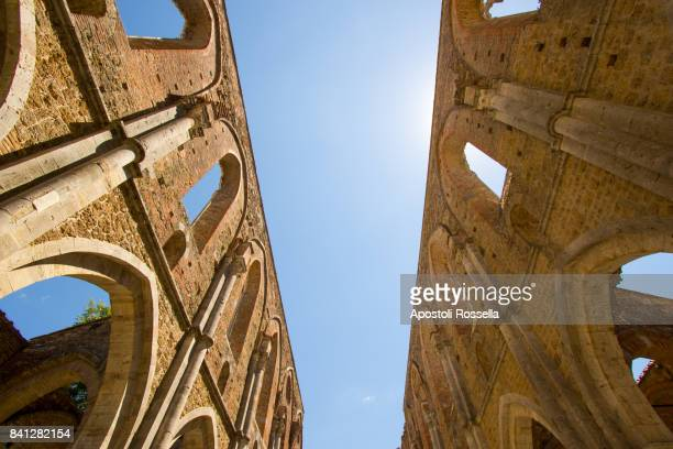 Indoor view of old roofless abandoned cathedral in San Galgano. Tuscany,